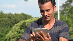 Young Hispanic Man Using Tablet. A handsome adult hispanic man stock video