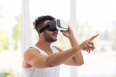 Young Hispanic Man Wear Virtual Reality Digital Glasses, Happy Smiling Guy Point Finger Stock Images