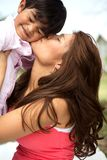 Young Hispanic mother and her son. Portrait of a young Hispanic mother and her son Stock Photography