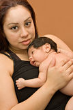 Young Hispanic Mother and Newborn Infant. Vertical color portrait of young hispanic mother holding her newborn baby on her chest Royalty Free Stock Photo