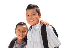 Young Hispanic Student Brothers Wearing Their Backpacks on White Stock Image
