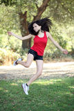 Young hispanic teen woman jumping outdoors. Young latina teen girl jumping outdoors motion blur stock photography