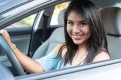 Young hispanic teenage girl learning to drive stock images