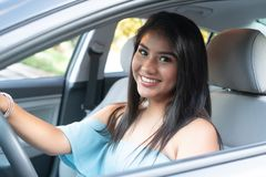 Young hispanic teenage girl learning to drive royalty free stock photography