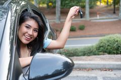 Young hispanic teenage girl learning to drive stock photos