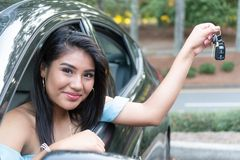 Young hispanic teenage girl learning to drive royalty free stock photo
