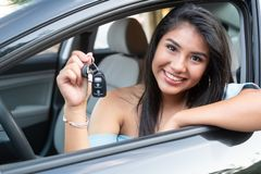 Young hispanic teenage girl learning to drive royalty free stock image