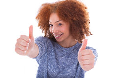 Young hispanic teenage girl making thumbs up gesture isolated on Royalty Free Stock Image