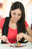 Young hispanic woman eating a seafood octopus Royalty Free Stock Photography