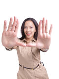 Young hispanic woman framing face with hands Stock Photo