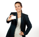 Young Hispanic woman holding a blank business card. Young, beautiful hispanic female, with long hair, holding a blank business card Royalty Free Stock Photography