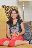 Young Hispanic woman at home Stock Image