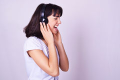 Young hispanic woman listening to music with headphones Royalty Free Stock Photography