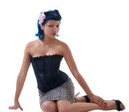 Young Hispanic Woman Sitting on floor. Young Hispanic woman in skirt and corset Royalty Free Stock Image