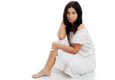 Young hispanic woman sitting with legs crossed Stock Photos