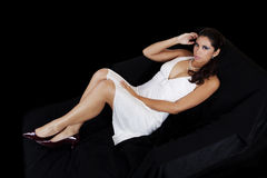 Young hispanic woman white dress on black Royalty Free Stock Images