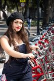 Young hispter lady using the street bikes of the mexican urban program EcoBici. Mexico City Mexico stock photography