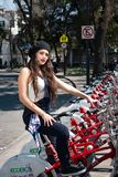Young hispter lady using the street bikes of the mexican urban program EcoBici. Mexico City Mexico royalty free stock photos