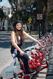 Young hispter lady using the street bikes of the mexican urban program EcoBici. Mexico City Mexico royalty free stock photography