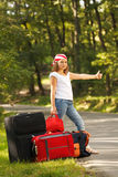 Young hitch-hiker girl Royalty Free Stock Photo