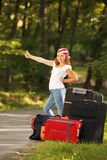 Young hitch-hiker girl Royalty Free Stock Image