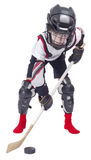 Young hockey player at ammunition. On white background royalty free stock image