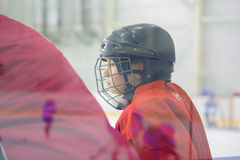A young hockey player. Young hockey player has to wait on the bench Royalty Free Stock Photography
