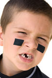 Young hockey player snarling Royalty Free Stock Image
