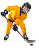 Young hockey player with stick and puck. Full length portrait of young hockey player in yellow uniform, with stick and puck. On the white background royalty free stock photos