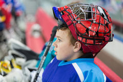A young hockey player in a stylish helmet royalty free stock photography