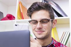 Young at home with mobile phone. Portrait of young at home with mobile phone and computer Royalty Free Stock Photo