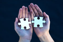 Young homeless boy holding puzzles Royalty Free Stock Images