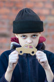 Young homeless boy holds a cardboard car Stock Photo