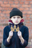 Young homeless boy holds a cardboard castle Royalty Free Stock Photography