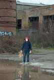 Young homeless boy on the street with bear. The young homeless boy on the street with bear Royalty Free Stock Photography