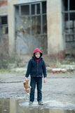 Young homeless boy on the street with bear. The young homeless boy on the street with bear Stock Image