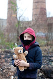 Young homeless boy on the street with bear. The young homeless boy on the street with bear Royalty Free Stock Images