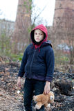 Young homeless boy on the street with bear. The young homeless boy on the street with bear Stock Photography
