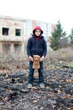 Young homeless boy on the street with bear Royalty Free Stock Photography