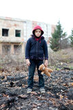 Young homeless boy on the street with bear Stock Photography