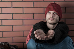 Young homeless man begging. For some money Royalty Free Stock Photo