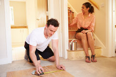 Young homeowners decorating their house Stock Photography