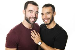 Young homosexuals gay couple love each other on a white background. royalty free stock image