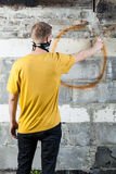 Young hooligan drawing a graffiti Royalty Free Stock Images