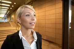 Young Hopeful Businesswoman. Young businesswoman in passageway of office building Royalty Free Stock Photography