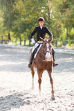 Young horse rider girl at the dressage competition Stock Photos