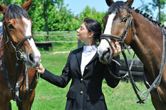 Young horsewoman with two horse Royalty Free Stock Photos