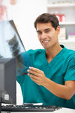 Young hospital doctor at desk Royalty Free Stock Photo