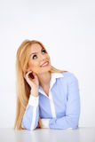 Young hot blonde woman thinking and smiling Stock Photos