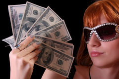 Young hot woman with dollars and glasses Stock Photography